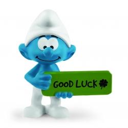 Figura Schleich® Los Pitufos - El Pitufo con su cartel Good Luck (20829)
