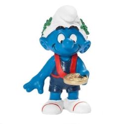 Figura Schleich® Los Pitufos - El Pitufo ganador con su medalla de oro (20745)