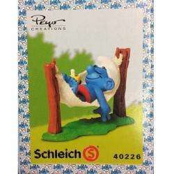 Figura Schleich® Los Pitufos - El Pitufo en su hamaca (40226)