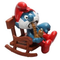 Figura Schleich® Los Pitufos - Papá Pitufo en su silla mecedora (40228)